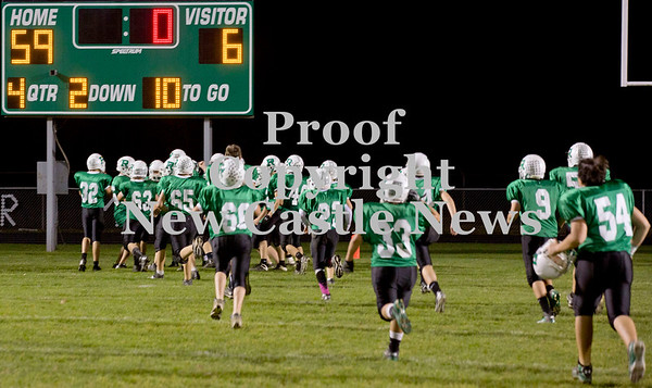 Scott R. Galvin / NEWS<br /> Riverside junior high players rush the field in celebration from the 59-6 victory over Neshannock for the junior high football championship on Thursday.