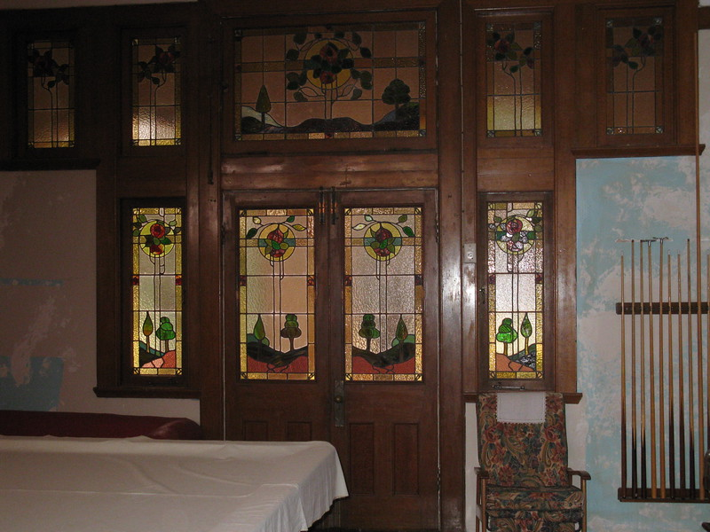 Stained glass windows in the billiards room