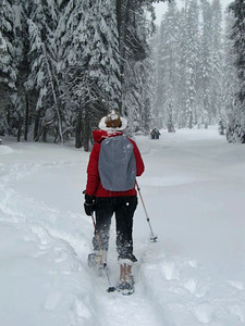 Carolyn got me from behind strolling along in a blizzard on the Dewey point Trail in my brand new snow shoes from REI.
