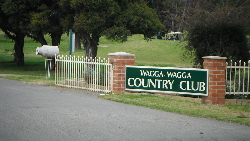 A very nicely written sign. And a milk crate. There might be some golf happening in the distance, but I'm not certain.