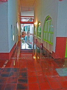 The corridors inside weren't much better. To get to the restaurant required a detour via the swimming pool - and a very large umbrella!