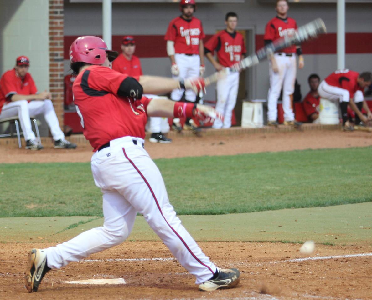 Number 15, Dusty Quattlebaum, hits the ball.
