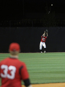 GWU outfielder sets up to catch the fly ball.