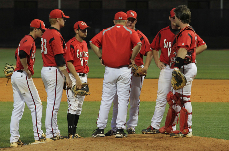 The infield huddled at the mound.