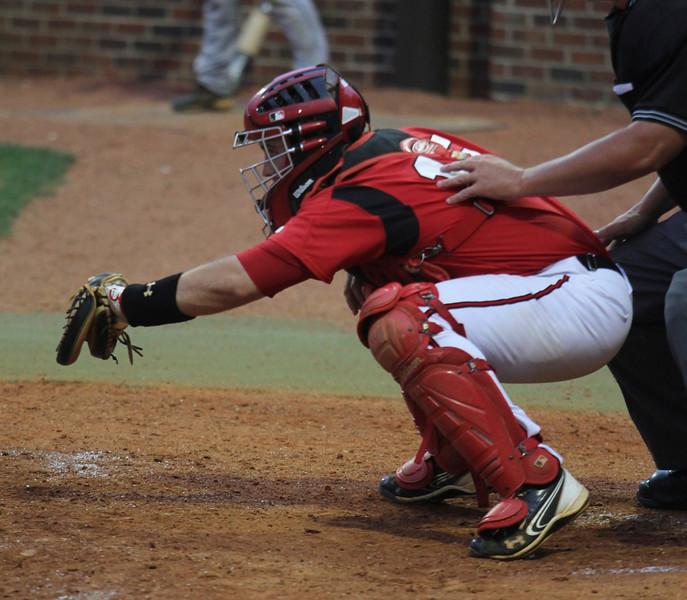 Number 15, Dusty Quattlebaum, catches the ball.