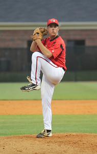 Number 10, Andrew Barnett, pitches the ball.