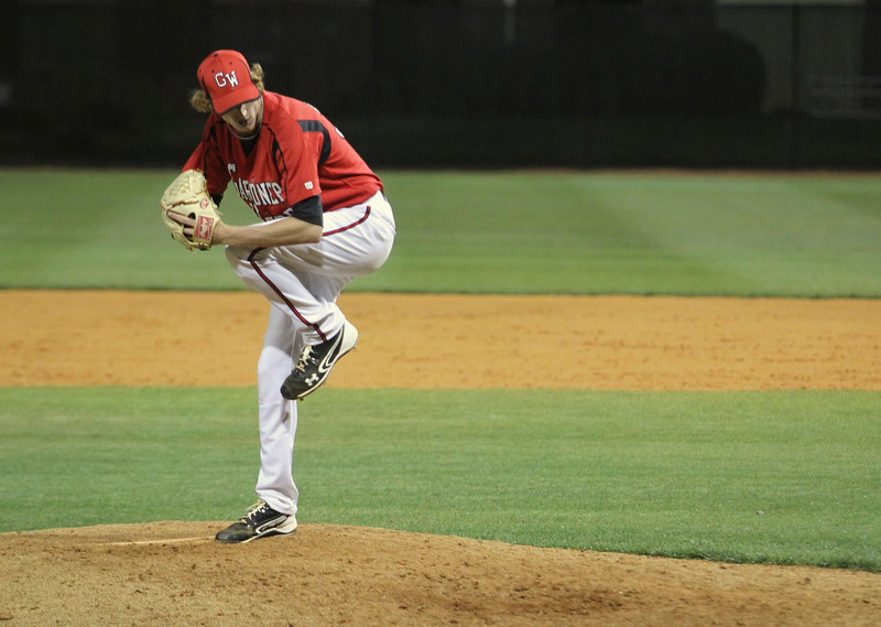 Number 37, Adam Izokovic, pitches the ball.