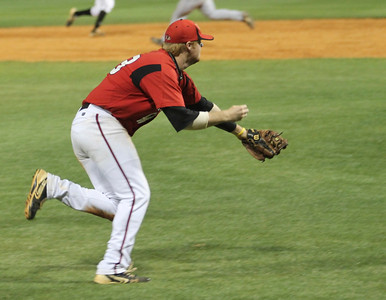Number 33, Brad Collins, runs to catch the bunted ball.