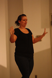 Lucy Perez performs her senior poem during Deaf Performance Night