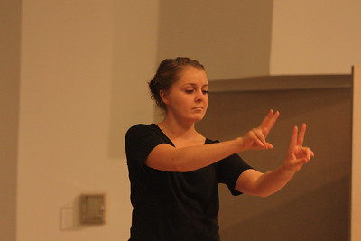Kate Carlin performs her senior poem during Deaf Performance Night