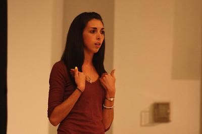 Jessica Brown performs her senior poem during Deaf Performance Night