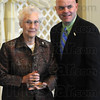 Sister Jeanne Knoerle accepts her 2012 Women of Influence award from Troy Fears, executive director of the United Way of the Wabash Valley.