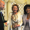 Karen Goeller accepts her 2012 Women of Influence award from Claudia Tanoos and Troy Fears of the United Way of the Wabash Valley.