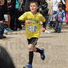 Fun winner: St. Patrick's first-grader Jaden Wayt takes the victory in the Fun Run portion of the Steve Weatherford event Saturday at Fairbanks Park.
