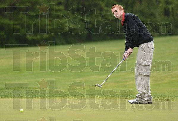Drop: Luke Peoples watches as his ball drops into the cup on the first hole of action during the MIC tournament.