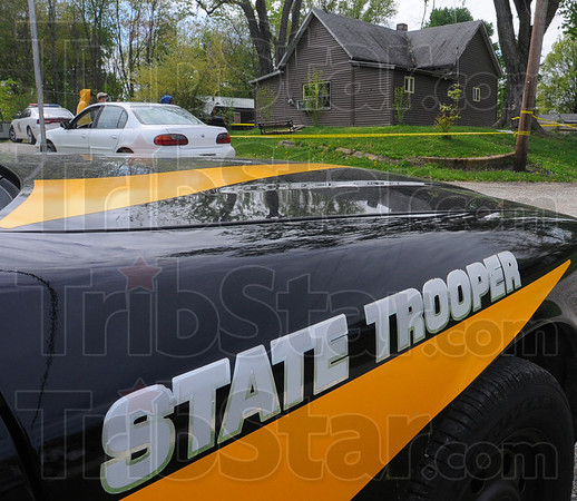 Tribune-Star/Jim Avelis<br /> Police response: Several vehicles from a variety of law enforcement agencies were outside the house at 611 Meadow in Hymera Thursday afternoon. A man was found dead on the kitchen floor of the home early in the day.