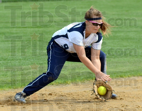 Tribune-Star/Jim Avelis<br /> Stopper: St. Mary-of-the-Woods shortstop Shelby Barnett scoops up a ground ball in the Pomeroy's win.