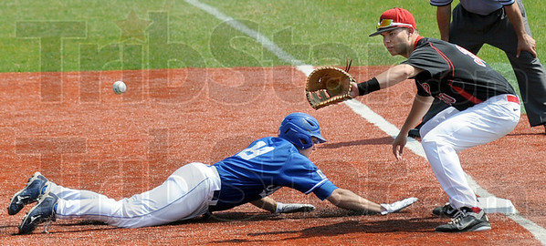Back: Indiana State's #19, Robby Ort dives back into first base during a pick-off attempt during game action with Illinois State. Redbird first baseman #30 Kyle Stanton waits for the ball.