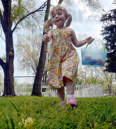 Fun: Four-year-old Kristian Carty races toward a hidden egg in the grass Sunday morning during the Dressser Community Church egg hunt.
