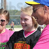 First pitch: Katie Candrol (center) threw out the first pitch of the tournament and awarded trophies at the end of the weekend softball event. She's flanked by her mother Lisa and father Ken during Saturday's games.