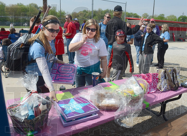 Auction items: New Goshen residents Shelly Edington and her mother Sherry look at some of the items up for auction during Saturday's ball games at the Miss Softball complex.