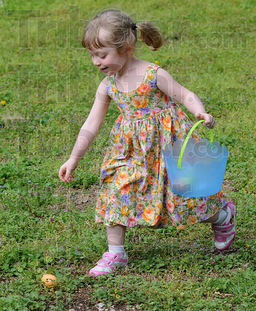 Golden egg: Four-year-old Kristian Carty goes for the gold during Sunday's Easter egg hunt sponsored by the Dresser Community Church.