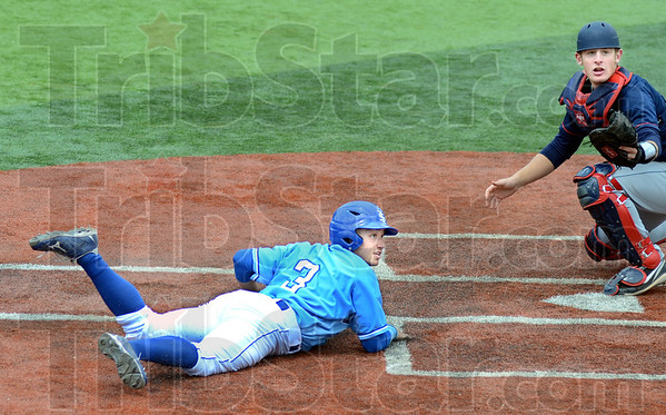 Score: Indiana State's #3, Kyle Burnam looks to the umpire for a call after sliding across the plate during game action with Dallas Baptist. He was safe on the play.