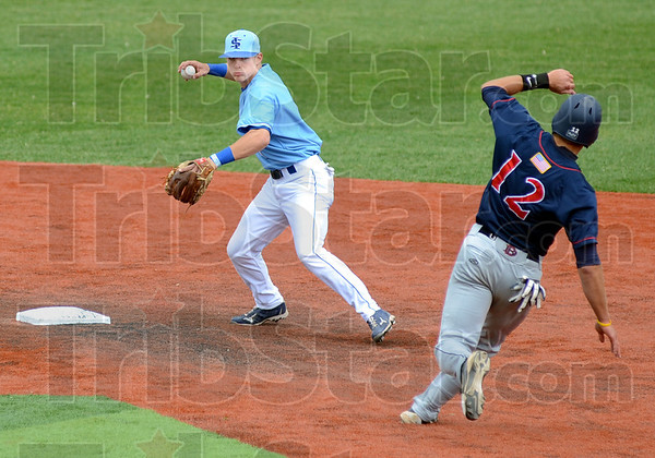 Turn two: Indiana State's Tyler Wamples prepares to throw to first base for a double-play during game action against Dallas Baptist Sunday afternoon. Dallas Baptist runner #12, Joel Hutter prepares to duck out of the way of the throw.