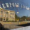 Reflection: The Vermillion County Courthouse reflects off the window of the Newport Lions Club's newly restored office.