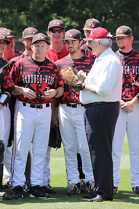 Republican presidential candidate Newt Gingrich throws the first pitch at the Gardner-Webb versus North Carolina A&T baseball game