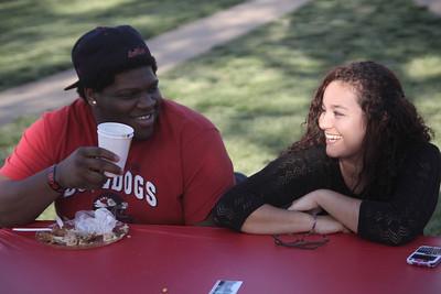 Sophomore, Jaris Williams and Senior, Roxana Bucur laugh at Dinner on the Quad Friday, April 13th.