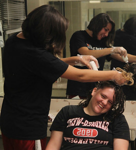 Caroline Nethery dyes Julia Kiser's hair in Decker's bathroom.