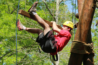 Micheal Cromeans, freshman at GWU, attempts to master the Corporate Ladder on the Broyhill Adventure course.  Photo by Bryan Cooper.