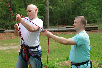 Graduate student, Andrew Morris, and Maj.  Jackson Salter, head of GWU ROTC, man the climbing line for the cadet climbing.  Photo by Bryan Cooper.