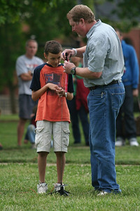 Students and community members participate in a Rocket Building Contest.