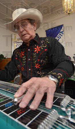 Tribune-Star/Jim Avelis<br /> All country: Leon Mercer plays the steel guitar for the Cowboy Church. The non-denominational gathering will have its first service tomorrow at 10:00a.m. in the Boot City Opry.