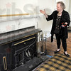 Ornate: Nancy Wagner talks about the mantel and fireplace in the home at 710 Liberty Street in Covington, Indiana.