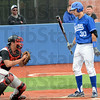 Gotcha: Maverick catcher Colby McCord is about to show the ball to Indiana State's #30, Jon Hedges after he went down looking for the final out of the game. Nebraska Omaha won 7-4 in twelve innings.