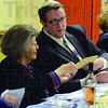 Tribune-Star/Jim Avelis<br /> Sharing: Louise Sommers accepts matzo bread from Rabbi Eric Mollo at the Seder meal at Temple Israel Friday night. The unleavened bread represented the haste that was needed to flee Egypt and slavery.