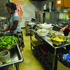 Tribune-Star/Jim Avelis<br /> Prep work: Kasandra Housley and Betsy Frank prepare the meal that will go along with the Seder meal at Temple Israel Friday night. Matzo soup, turkey and salad was served after the Seder meal.