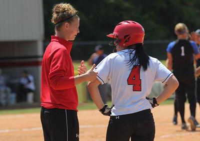 Assistant Coach, Diana Deal, talks to number 4, Savannah Burns.