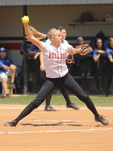 Number 7, Jessica Childers, pitches the ball.
