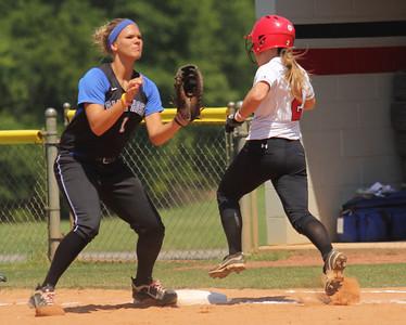 Number 2, Melinda Dulkowski, runs safely through first base.