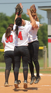 Teammates share hand shakes before the start of the inning.