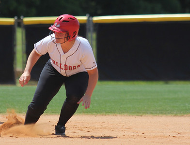 Number 17, McKenzie Morenus, takes a lead off of second base.