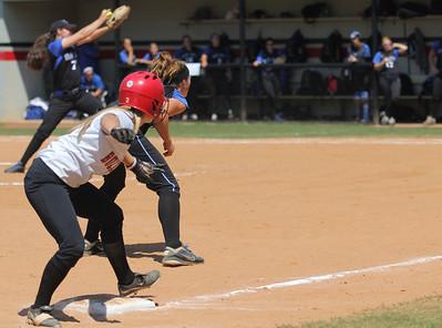 Melinda Dulkowski, 2, prepares to lead off of third base.