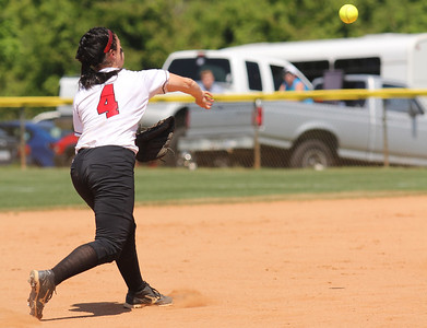 Short stop Savannah Burns, 4, throws the runner out at first.