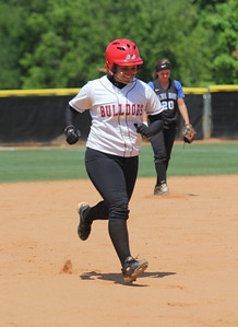 Amanda Gomes, 22, runs with a smile on her face after hitting a home run to bring in Samantha Meenaghan and Melinda Dulkowski for a 3 run RBI.
