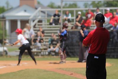 Head Coach Tom Cole watches on as Melinda Dulkowski, 2, steps up to bat.