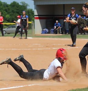 Savannah Burns slides safely at third base.